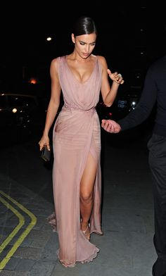 Supermodel Irina Shayk looked flawless in a blush silk chiffon #AtelierVersace gown. #VersaceCelebrities