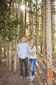 Summer Engagement Session - Red Lodge - Mountains - Trees - Sunset - Sun Through Trees - Fiance - Engaged Couple - Gray Pants - Blue Shirt - Green Shirt - Jeans - Holding Arm - Montana Wedding Photographer - Sara Nagel Photography Engagement Couple, Engagement Session, Engagement Photos, Red Lodge Mountain, Montana Wedding, Time Of Your Life, How To Pose, Gray Pants, Green Shirt