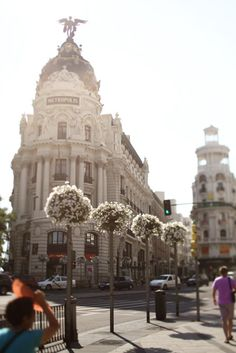 The Metropolis building is in Madrid, Spain, not Paris. Places Around The World, Oh The Places You'll Go, Places To Travel, Places To Visit, Around The Worlds, Travel Destinations, Dream Vacations, Vacation Spots, Vacation Places
