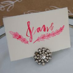 Placecard Holder using vintage brooches and earrings