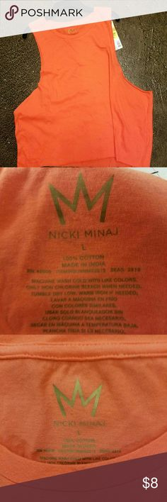 Nicki Minaj Nicki Minaj tank top hundred percent cotton very very soft from the center of the front to the bottom is 18 inches. Nicki Minaj Tops Tank Tops