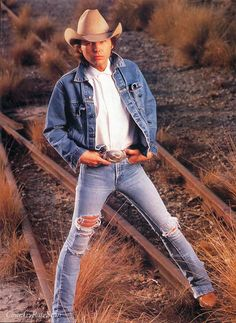 Dwight Yoakam. Just try to be cooler. holey jeans and worn-out boots.   {junk gypsy co - http://gypsyville.com/ }