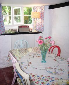 country cottage kitchen - love the mismatched chairs,this is nearly the same as my dining room