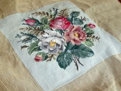 Completed floral needlepoint roses pinks whites grey green 11.5 in sq