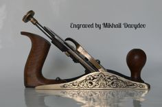 Brass plane decorated with hand engraving by Mikhail Davydov