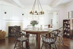 Steel 19th-century Windsor chairs surround a table by interior designer Thad Hayes in a Hamptons dining room.