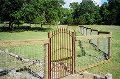 cattle fences and gates   iron gate custom wrought iron with stone columns ranch pipe fence gate ...