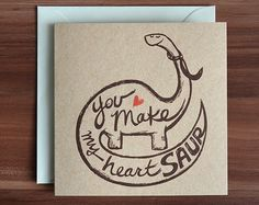 This dinosaur love card is part of a pun card series, featuring cute creatures and graphic designs, sure to make that special someone smile!