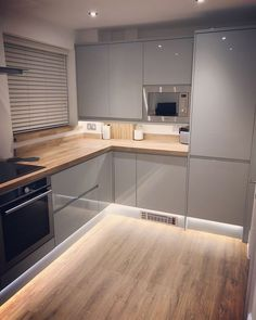 Finally, our new kitchen! Gloss Grey handleless Clerkenwell from @howdensjoinery . . . . #howdens #clerkenwell #kitchen #newkitchen… #diykitchencabinets