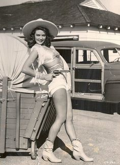 Packing heat vintage cowgirl style.