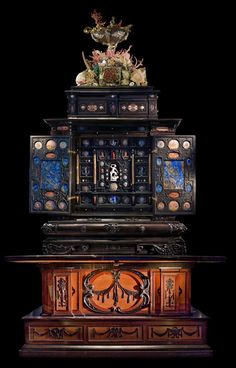THE AUGSBURG ART CABINET. The 'Augsburg Art Cabinet' from 1632 contained collections of exotic items, new inventions, and technically complicated objects. The Art Cabinet originally belonged to Swedish King Gustavus Adolphus, but it was later donated to Uppsala University. http://www.uu.se/en/about-uu/culture/