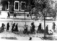 Warsaw, Poland, Jews marching with their belongings, apparently in a deportation to the ghetto.
