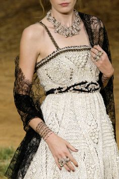 Beautiful sparkly necklace, rings, and trimmings on crocheted dress via: all the beauty things...