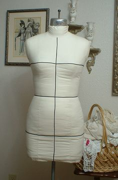 Dressform Tutorial, use commercial dress form, pad to match your figure, tailor muslin to fit and spray to shrink tight.  A better way to use a hard shell commercial form which restricts pinning and draping ability.