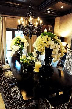 Beige and Black Dining Room.  Print Dining Chairs. Yellow flowers are a nice touch.