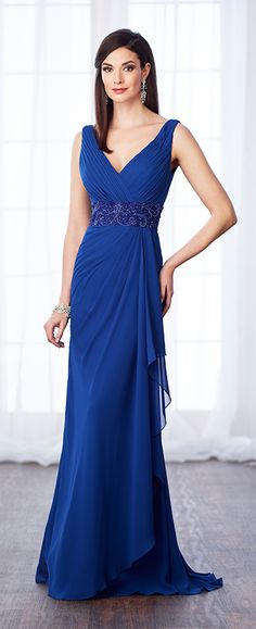 This sleeveless chiffon slim A-line gown features front and back V-necklines, directionally pleated bodice with a hand-beaded wide natural waistband.