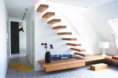 stairs with built in floating bench.