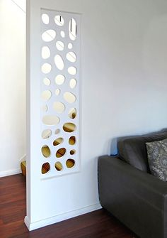 Laser cut screening - River stones.  This painted 25mm thick timber decorative  screen offers a very architectural solution to this 'hole in the wall' and adds an extra touch of style to this interior decor.