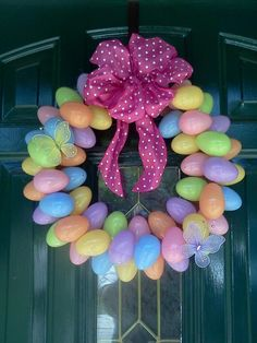DIY Easter Wreath.... I purchased the ribbon and butterflies at the Dollar Tree... I purchased the eggs from Walmart. I think the cost was around $7.00 :-)...