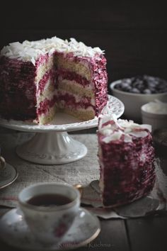 - Blackcurrant Cream Cake -   use white or chocolate cake layers,- blackcurrants fit's it all.. Cocos shavings as topping