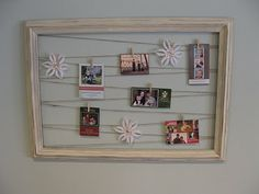 Take an empty frame, paint it. Add tacks to the back and string twine. Hang holiday cards or decor. Love this idea!