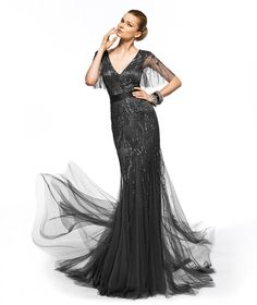 This is one of my favorites......Pronovias presents the Zenit cocktail dress from the 2013 Long collection. Dark gray bridesmaids dress