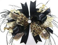 Black and Gold Leopard Bling Over the Top Hair Bow with matching headband by sanchezc30 on Etsy https://www.etsy.com/listing/114580466/black-and-gold-leopard-bling-over-the