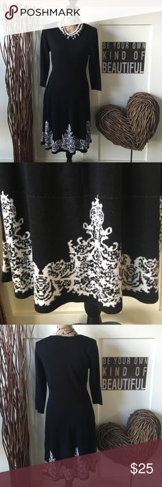 So pretty black knit dress w/patterned hemline This lightweight knit dress as three-quarter length  sleeves and a scoop neck. a slight flair with a patterned white hemline that makes this dress stand out in a crowd. So pretty and feminine.  Approx 39 in from shoulder to hem. Cato Dresses Midi