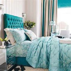 Teenage girls bedroom, looking for a new bed and cover for a new house. I love this turquoise color and this really pretty backboard!