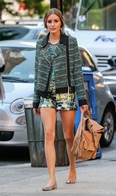 Olivia Palermo mixed a striped top with abstract shorts and a bouclé motorcycle jacket in NYC.