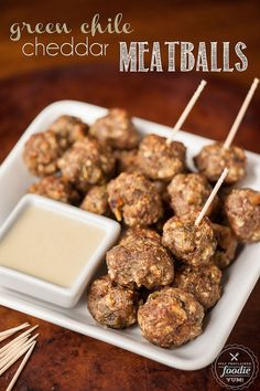 Four ingredient Green Chile Cheddar Meatballs are easy to make, taste fantastic with white cheddar cheese sauce, & can be eaten as a main dish or appetizer.