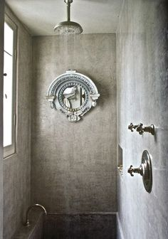 Concrete walls, bright fixtures, zinc mirror - all interesting.   I'm afraid I'd feel like I'm bathing in a dungeon, though, with the tub tucked all the way in the back of this alcove.   Gilles Trillard photo