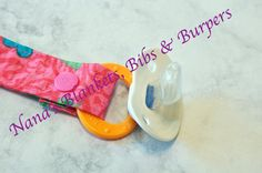 Pacifier Clip / Pink with blue and yellow by NanasBlanketsBibs