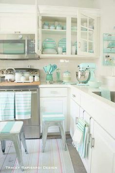 kitchen with cute Aqua accent pieces