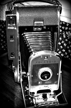 Polaroid Land cameras - one of the first instant cameras, you only had to wait a minute to see your picture...