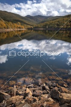 Reflections in the lake on sunny autumn day