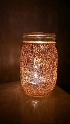 Mason jar candle. Glue the jar and then sprinkle with glitter . Did it myself :) Evening Wedding Decor, Mason Jar Candles, Mason Jar Lamp, Light Up, Celebration, Jar Candles