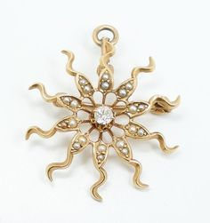 This gorgeous Victorian era piece of jewelry can be worn either as a brooch or as a necklace pendant. The pin is superbly crafted in 14k yellow gold with an exceptional sunburst motif. The sun is set with a multitude of dainty seed pearls as the sun's rays radiate and curl outward.   eBay!
