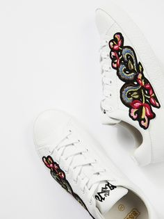 Nak Embroidered Sneaker   Textured leather sneakers featuring a colorful and statement embroidery patch on the side. * Lace-up * Padded footbed