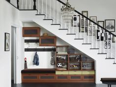 Storage underneath an entry staircase is the perfect place to hide all the shoes, keys, backpacks and coats that always end up crowding the floor space next to the front door. This allows for grab-and-go access for often-used items.