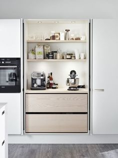 Bakers cabinet- ingredients, mixers, and everything you need all at Uora finger tips. Work counter in closet as well. Beautiful doors to close it off.