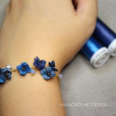 Love my new bracelet. flowers are handcrocheted from silk thread with crochet hook . Love my new bracelet. flowers are handcrocheted from silk thread with crochet hook . Crochet Car, Crochet Hood, Crochet Puff Flower, Crochet Flower Patterns, Cute Crochet, Crochet Flowers, Hand Crochet, Diy Jewelry, Jewelery