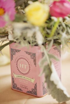 Love how they re-used tea tins for florals!