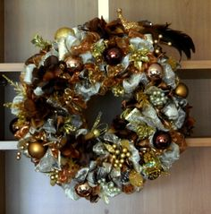 This is a 12 inch wreath, tho is 14 to 15 inches all finished.  This one is all shades of browns and golds.  Again I use all silk florals in here and top quality ornaments too.  I have a client that purchases these from me and gives them as gifts to his clients.  Each one is customized.