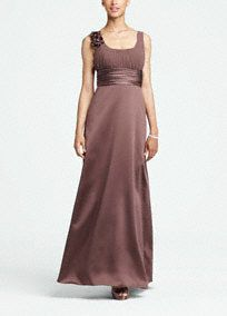 This elegant ball gown is memorable and unique, a great choice for any member of the bridal party. Chiffon bodice is accented with floral detail on the shoulder that is on trend for the season. Ruched waist is flattering and flows into a full satin skirt to create a beautiful contrast of fabrics. Fully lined. Imported polyester. Dry clean only. Samples available in limited stores, available for special order in all stores. Get inspired by our colors. Sizes and colors are available in limited…