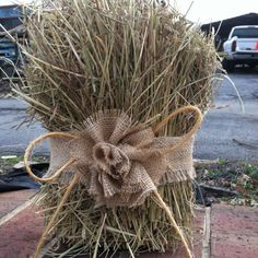 Hay bale decor for country wedding. Outside on either side of entrance with splash of satin color added (coral?)