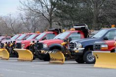 Plow trucks are lined up in a parking lot behind Colonie Center on Monday, Feb. 27, 2012 in Colonie, N.Y. Snow is predicted for the Capital Region later this week. (Lori Van Buren / Times Union)