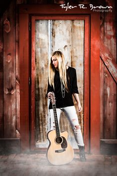 We love this photo of Kaity standing in front of a wooden door, with her guitar, as the fog rolls in.