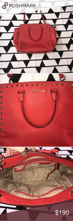 """Large red/orange authentic MICHAEL KORS bag Very good condition large Michael Kors Selma bag nowhere on the inside only flaw is no longer being """"stiff"""" on the sides there's also a tent on the back just from carrying it up against myself however that could easily be cleaned before shipping it's 100% authentic paid full price for its gorgeous and has lots of life left just decided to upgrade. Retails for $358 without tax. Cross posted Michael Kors Bags"""