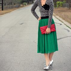 Green skirt with a gray snow leopard blouse and a black flower pin